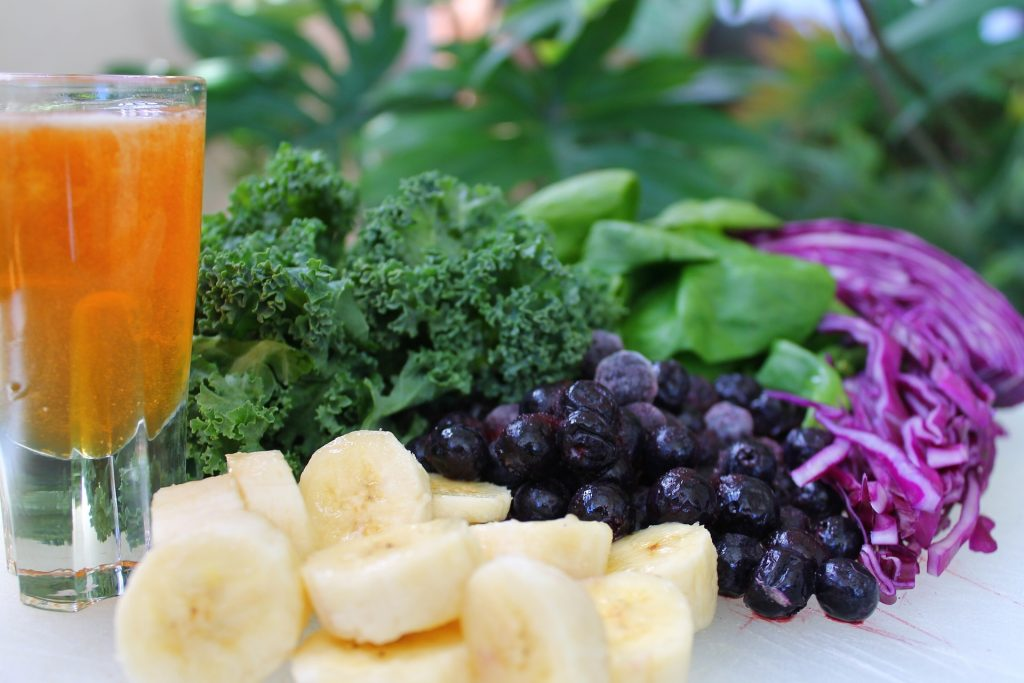 Juice with vegetables, berries, and bananas