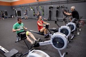 FIT members on rowing machines